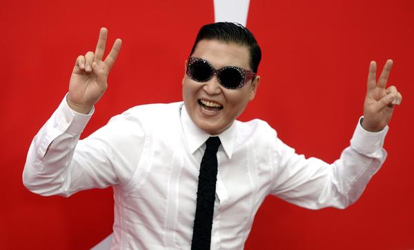 "Psy, pictured with talent manager Scooter Braun, said he might retire his hit song ""Gangnam Style."""