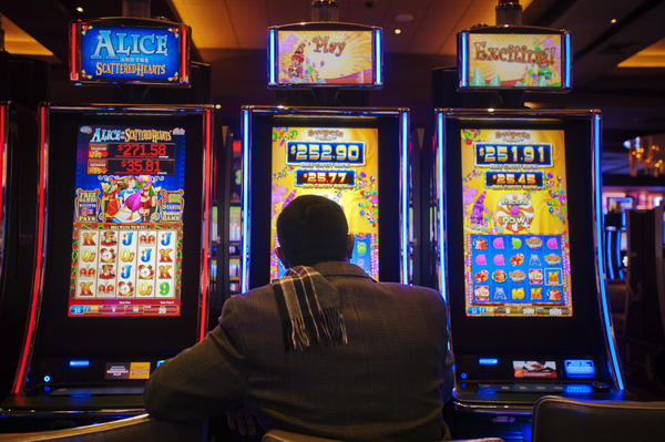 Solomon Fersha tries his luck at Maryland Live casino Friday, Dec 28, 2012. The casino is now open around the clock.
