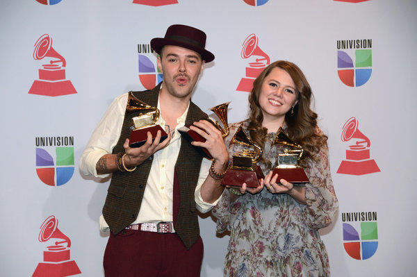 Sibling musicians Jesse and Joy Huerta with their Latin Grammy awards for record of the year, song of the year, contemporary pop vocal album and short form music video.