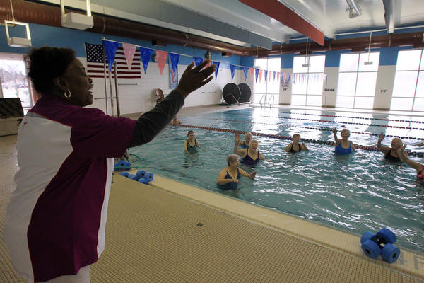 Employee Betty Fisher waves goodbye to the ladies in the water aerobics class at the Lake County Family YMCA.