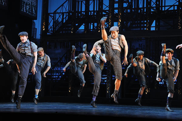 "The high-kicking cast of Disney's ""Newsies"" on Broadway."