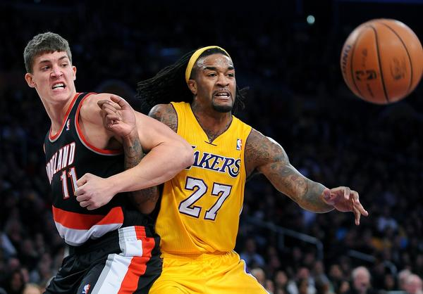 Jordan Hill and Trail Blazers big man Meyers Leonard battle for a rebound.