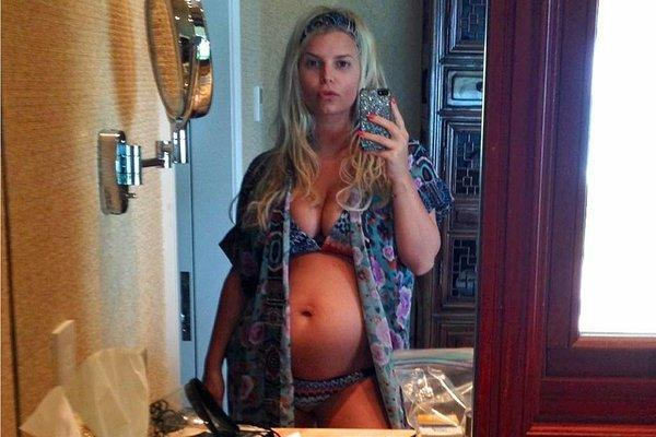 Jessica Simpson shows off her newest baby bump on vacation in Hawaii.
