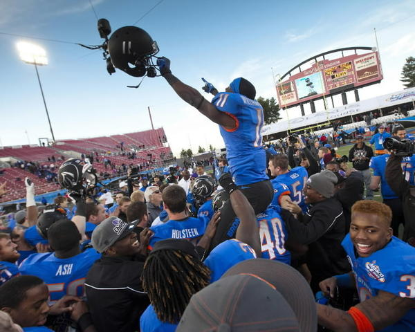 Boise State wide receiver Shane Williams-Rhodes is hoisted onto the shoulders of his teammates during the post-game celebration in the MAACO Las Vegas Bowl at Sam Boyd Stadium in Las Vegas, Nevada, Saturday, December 22, 2012. The Broncos defeated Washington, 28-26. (Darin Oswald/Idaho Statesman/MCT)