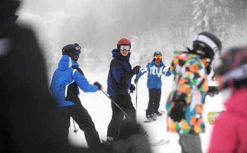 Skiers and snowboarders enjoy the day at Blue Mountain Ski Area on Monday.