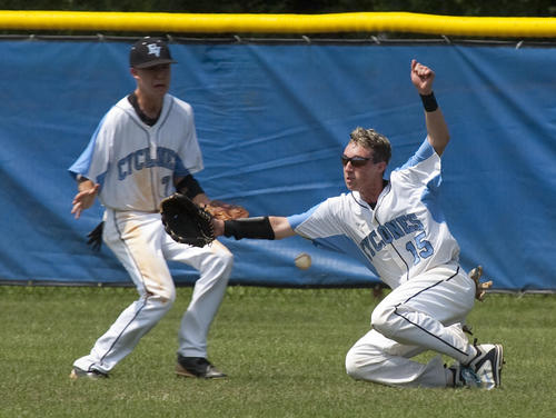 Brandon Settle (left) looks on as AJ Stead fails to get the handle on a af fly ball during the 5th inning action against York High School Monday. York went on to win the game 5-2.