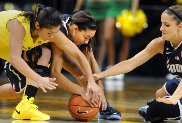 UConn's Bria Hartley, center, and Caroline Doty, right, battle Oregon's Jordan Loera, left, for a loose ball at Matthew Knight Arena Monday afternoon. Doty had 14 points, a career-high 12 rebounds and had seven assists and four steals.