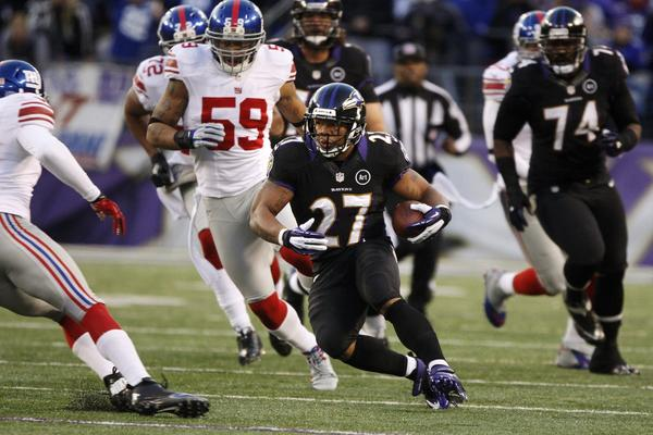 Ravens running back Ray Rice picks up a few yards in the first half against the New York Giants.