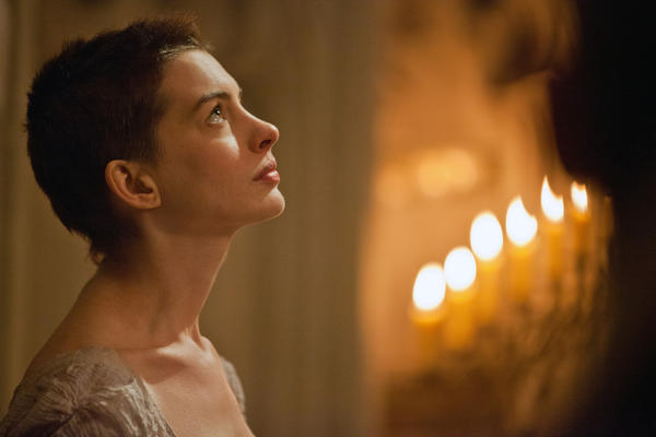 "This publicity film image released by Universal Pictures shows actress Anne Hathaway portraying Fantine, a struggling, sickly mother forced into prostitution in 1800s Paris, in a scene from the screen adaptation of ""Les Miserables."