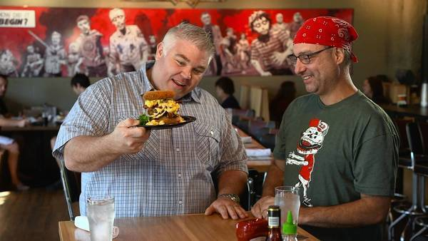 Todd Fisher, left, and owner George Formaro with the Walking Ched at Zombie Burger.