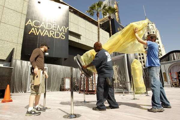 Oscar statues are moved into place for the 85th annual Academy Awards.