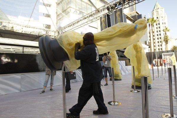 Oversize Oscar statues being moved into place in front of the Hollywood & Highland Center ahead of last February's Academy Awards.