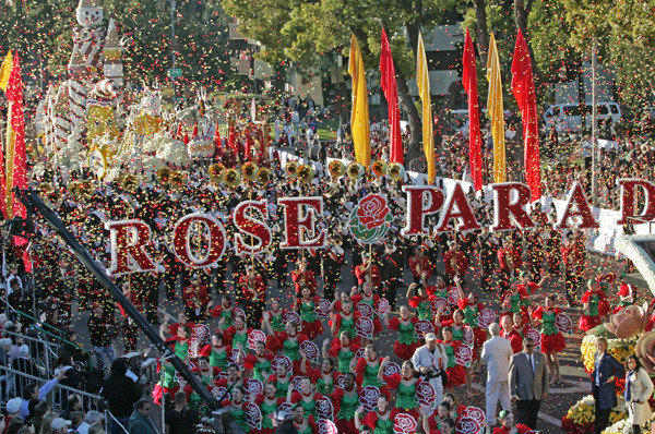 "Members of Wells Fargo theme float ""Just Imagine..."" moves along Orange Grove Boulevard during the 123rd Tournament of Roses Parade in Pasadena."