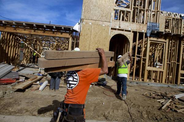 Lumber prices skyrocketed in November as lumber sellers with low inventory tried to meet a surge in demand for domestic consumption as housing starts reached a four-year high. Above, a home is under construction in December in Rancho Santa Fe, Calif.