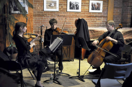 Three members of Quartetto Vivo, a string quartet based in Hartford, performs at the Buttonwood Tree as part of the Middnight on Main New Year's Eve celebration in downtown Middletown. The event includes performances, children's entertainment and fireworks.