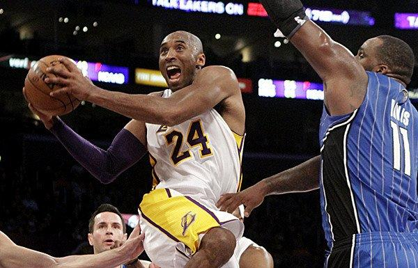 Lakers guard Kobe Bryant, driving to the basket against the Magic's Glen Davis, had the best statistical month of any during his 17 seasons in the NBA.