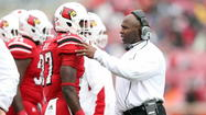 Charlie Strong gives Rocky Top a heaping helping of Louisville loyalty