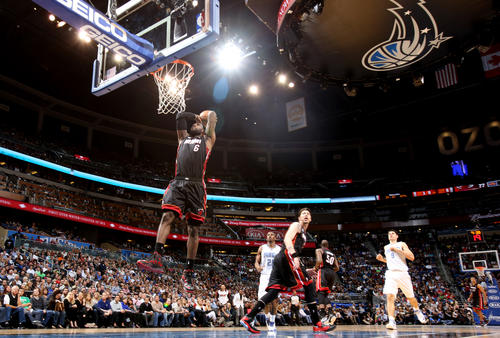 Miami forward LeBron James (6) dunks off a fast break during the second half of the Heat's 112-110 overtime victory over the Orlando Magic in Orlando, Fla.