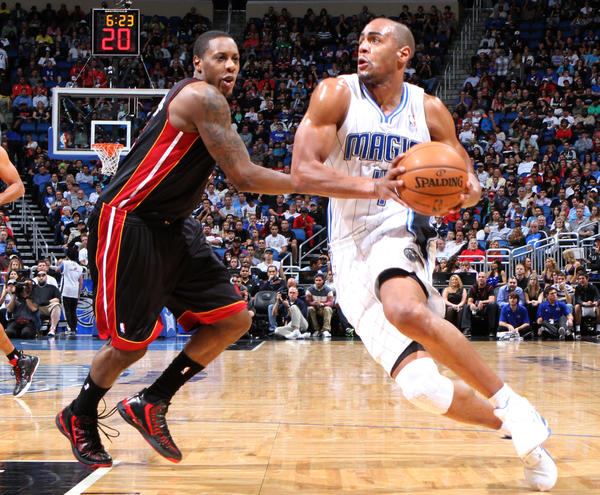 Orlando forward Arron Afflalo (4) drives against Miami guard Mario Chalmers (15) during the first half of the Magic's game against the Heat in Orlando, Fla.