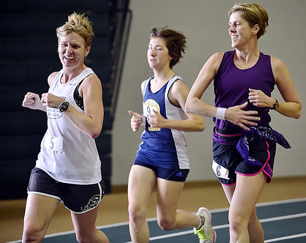 Kathleen Luzier, left, Erin Hub and Mary Zielinski compete in the first Hawk Indoor Marathon on Monday at Hagerstown Community College.