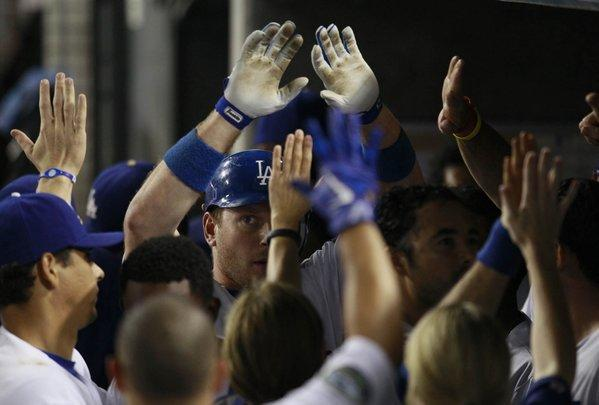 Dodgers catcher A.J. Ellis, a blogger's best friend, is surrounded by teammates after hitting a home run.