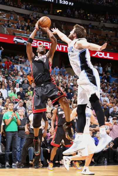 Miami center Chris Bosh (1) shoots over Orlando forward Josh McRoberts (17) at the end of regulation during the Heat's 112-110 overtime victory over the Magic in Orlando, Fla.