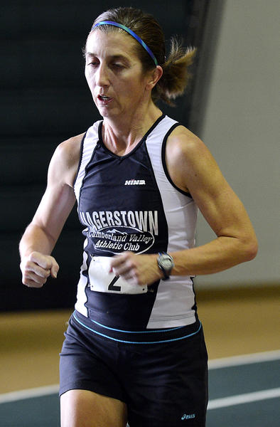 Laurie Dymond of Chambersburg, Pa., set a women's 40-and-older world record at the Hawk Indoor Marathon on Monday at Hagerstown Community College, finishing the 26.2-mile race in 3 hours, 20 minutes and 23 seconds.