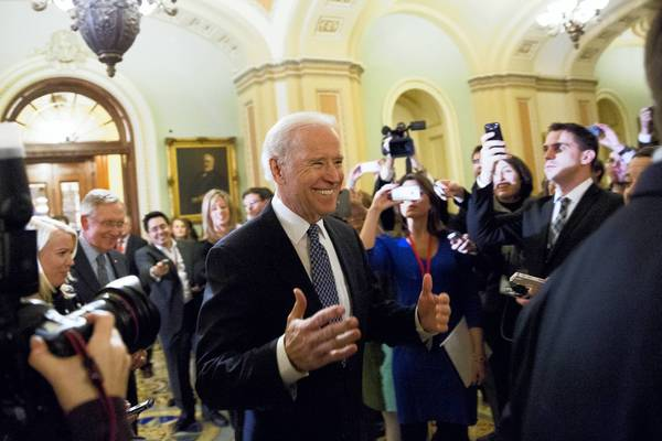 U.S. Vice President Joe Biden arrives for a closed-door meeting with Senate Democrats to urge them to support a tentative tax agreement with Senate Minority Leader Mitch McConnell (R-KY) on Capitol Hill in Washington DC.