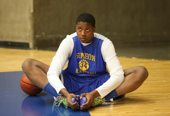 Simeon's Quron Davis stretches during a practice in Texas earlier this season.