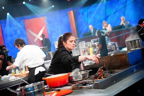 "Alex Guarnaschelli takes part in Food Network's ""The Next Iron Chef"" show. Tribune Co. is expected to maintain its 30% stake in the profitable network."