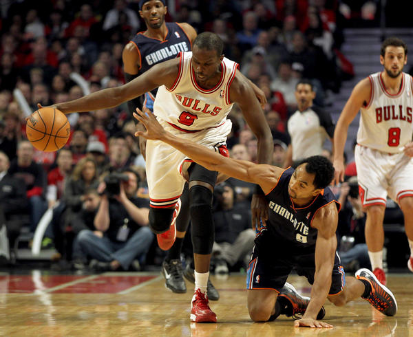 Luol Deng avoids the Bobcats' Gerald Henderson during Monday's game.