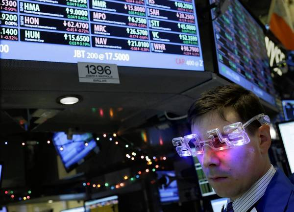 Wall Street optimism about 2013 remains rooted in expectations that the U.S. economy will continue to expand, albeit slowly, and with it corporate earnings. Above, a trader works on the floor at the New York Stock Exchange on New Year's Eve.