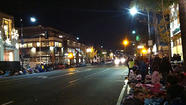Rose Parade fans stake out prime spots on a chilly night