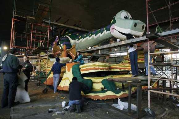 "The La Canada Flintridge float, ""Dino-Soar,"" under construction days before the 124th Rose Parade."