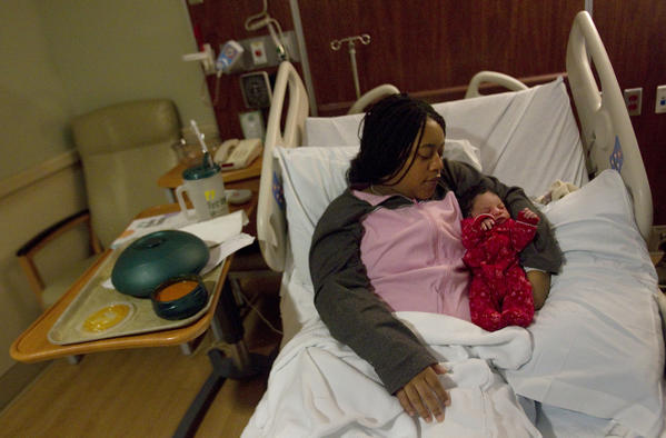 Niechelle Chesley-Keys rests with newborn daughter Mariah Rain Keys at Riverside Regional Medical Center on Tuesday afternoon. Mariah, delivered at 3:12 a.m., is the first baby to be born in 2013 on the Peninsula.