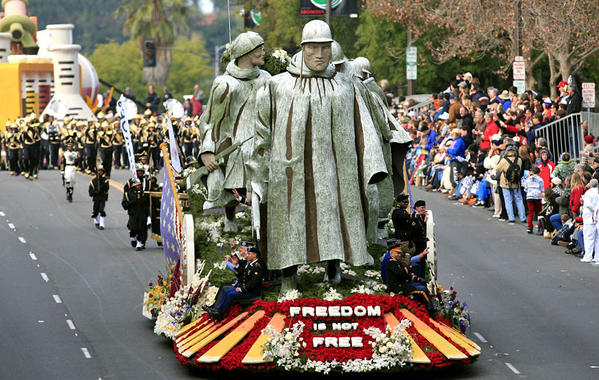 "The Department of Defense 60th Anniversary of the Korean War Commemoration Committee's ""Freedom Is Not Free"" float pays tribute to Korean War veterans."
