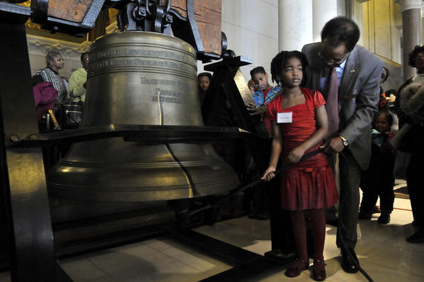 Glenn Cassis, executive director of the African-American Affairs Commission, instructs his daughter, Aniya Cassis, moments before she rang the Capitol's Liberty Bell replica to mark the 150th anniversary of the Emancipation Proclamation during a celebration at the state Capitol Tuesday.