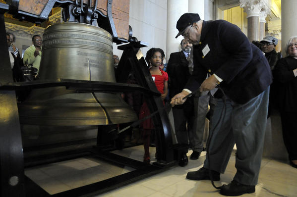 Emmanuel Gomes takes a turn ringing a replica of the Liberty Bell during a celebration marking the 150th anniversary of the Emancipation Proclamation at the state Capitol Tuesday. Gomes is a member of the of the Descendants 2 of the 29th Connecticut Colored Infantry Regiment