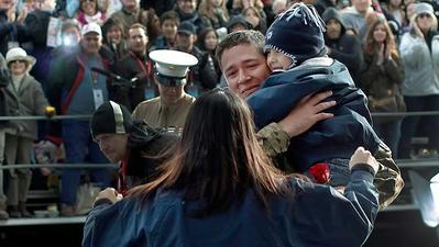 Soldier reunited with family in Rose Parade's most surprising moment