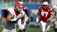 ORLANDO, Fla. -- Aaron Murray threw five touchdown passes to set a Georgia bowl record, including two in the fourth quarter, as the sixth-ranked Bulldogs beat No. 23 Nebraska 45-31 in the Capital One Bowl on Tuesday.