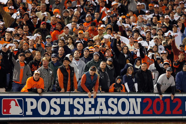 Fans cheer in the ninth inning of the Orioles' 3-2 win over the New York Yankees in Game 2 of the ALDS.