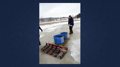 Before any hockey could be played Tuesday at The Catholic Pond in Somereset, The Pond Crew had to prepare the ice. R.J. Flower, Pond Chief, led a small team of fellow players as the put to use his Homeboni to prepare the frozen pond.