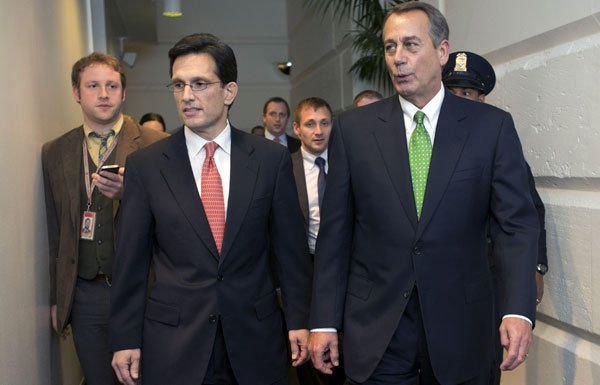House Majority Leader Eric Cantor and Speaker John Boehner arrive at the U.S. Capitol for a second Republican Caucus meeting on Tuesday.