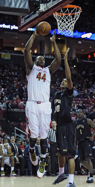 "Maryland's Shaquille Cleare, left, goes up for a dunk over <a class=""taxInlineTagLink"" id=""OREDU0000528"" title=""Indiana University-Purdue University Indianapolis"" href=""/topic/education/colleges-universities/indiana-university-purdue-university-indianapolis-OREDU0000528.topic"">IUPUI</a>'s Donovan Gibbs in the second half."