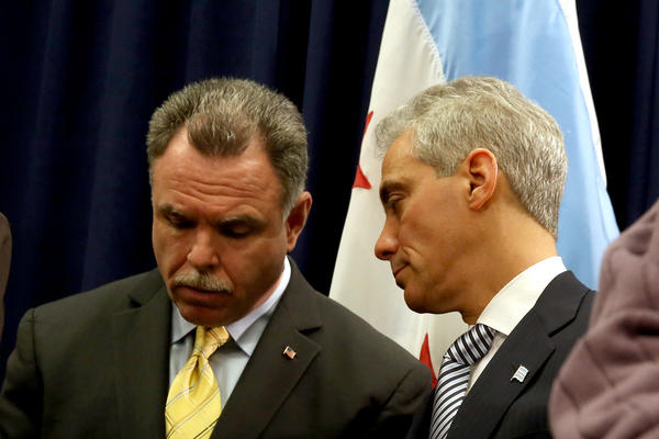 Chicago Mayor Rahm Emanuel speaks to Chicago Police Superintendent Garry McCarthy, at a event in support of tighter gun control legislation Dec. 20.