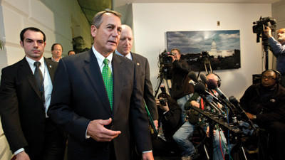 "Speaker of the House John Boehner, R-Ohio, walks with House Ways and Means Committee Chairman Dave Camp, R-Mich., following a closed-door GOP meeting as the ""fiscal cliff"" bill passed by the Senate Monday night waits for a vote in the Republican-controlled House, at the Capitol in Washington, Tuesday."