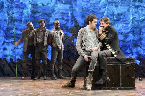 "Christian Borle, right, plays a scene with Adam Chanler-Berat, second from right, in ""Peter and the Starcatcher."" Looking on at left are Matt D'Amico, Rick Holmes and Isaiah Johnson."
