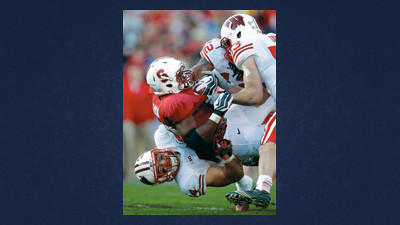 Wisconsin linebacker Chris Borland, bottom, brings down Stanford running back Stepfan Taylor during the second half of the Rose Bowl NCAA college football game Tuesday in Pasadena, Calif.