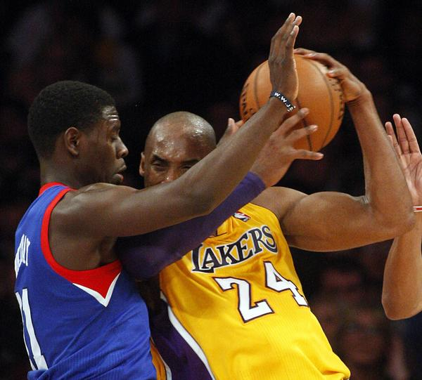 Sixers guard Jrue Holiday applies pressure defense on Lakers guard Kobe bryant in the fourth quarter.