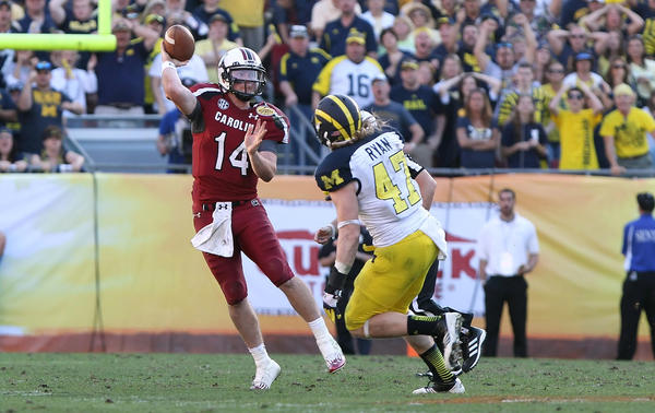 South Carolina Gamecocks quarterback Connor Shaw (14) throws the ball as Michigan Wolverines linebacker Jake Ryan (47) attempted to defend during the second half of the 2013 Outback Bowl at Raymond James Stadium. South Carolina Gamecocks defeated the Michigan Wolverines 33-28.